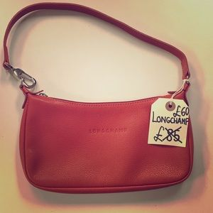 Authentic Longchamp leather satchel.